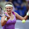 Belarus\' Victoria Azarenka hits a forehand against German Mona Barthel during their quarterfinal match at the Porsche tennis Grand Prix in Stuttgart, Germany, Friday, April 27, 2012. (AP Photo/Michael Probst) ORG XMIT: PSTU110