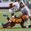 Oklahoma Sooners fullback Trey Millard (33) is brought down by UTEP\'s Derrick Morgan (21) during the college football game between the University of Oklahoma Sooners (OU) and the University of Texas El Paso Miners (UTEP) at Sun Bowl Stadium on Saturday, Sept. 1, 2012, in El Paso, Tex. Photo by Chris Landsberger, The Oklahoman