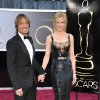 Photo - FILE - This Feb. 24, 2013 file photo shows musician Keith Urban, left, and his wife actress Nicole Kidman at the Oscars at the Dolby Theatre in Los Angeles. urban is a judge on the singing competition series,