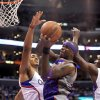 Los Angeles Clippers center Ryan Hollins, left, and forward Lamar Odom, right, defend as Phoenix Suns center Jermaine O\'Neal tries to put up a shot in the first half of an NBA basketball game in Los Angeles on Wednesday, April 3, 2013. (AP Photo/Richard Hartog)
