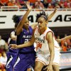 OSU's Kendra Suttles, right, works against Kansas State's Mariah White at Gallagher-Iba Arena on Saturday. Suttles scored 19 points and had 10 rebounds.