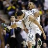 Photo - Michigan State guard Denzel Valentine, left, and forward Adreian Payne celebrate against Memphis in the second half of their third-round game of the NCAA college basketball tournament in Auburn Hills, Mich., Saturday March 23, 2013. Michigan State won 70-48. (AP Photo/Paul Sancya)