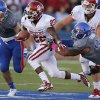 OU\'s Roy Finch (22) runs between KU\'s Jake Love (57) and Ben Goodman (93) during the college football game between the University of Oklahoma Sooners (OU) and the University of Kansas Jayhawks (KU) at Memorial Stadium in Lawrence, Kan., Saturday, Oct. 19, 2013. Oklahoma won 34-19. Photo by Bryan Terry, The Oklahoman