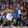 Oklahoma City Thunder\'s Kevin Durnat, right, keeps the ball from Philadelphia 76ers\' Evan Turner during their NBA preseason basketball game at the Phones4 u Arena in Manchester, England, Tuesday, Oct. 8, 2013. (AP Photo/Jon Super) ORG XMIT: MJS104