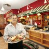 Nat Hardt, franchisee, holds an original Schlotzsky\'s sandwich in one of his restaurants, on W Memorial Road, Wednesday, Oct. 3, 2007. By Jim Beckel, The Oklahoman.
