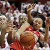 Ohio State\'s Martina Ellerbe, right, struggles with Nebraska\'s Emily Cady, left, and Meghin Williams, center, for a rebound in the second half of their NCAA college basketball game in Lincoln, Neb., Sunday, Feb. 26, 2012. Cady contributed 24 points as Nebraska won 71-57. (AP Photo/Nati Harnik)