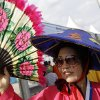 Photo - A fan of the South Korean national soccer team arrives to the Arena Pantanal before the group H World Cup soccer match between Russia and South Korea in Cuiaba, Brazil, Tuesday, June 17, 2014. (AP Photo/Thanassis Stavrakis)