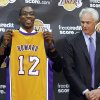 Center Dwight Howard, newly acquired by the Los Angeles Lakers from the Orlando Magic, poses with his Lakers jersey with Lakers general manager Mitch Kupchak, at a news conference at the NBA basketball team\'s headquarters in El Segundo, Calif. (AP Photo/Reed Saxon) ORG XMIT: CARS204
