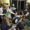 """Arthur Elementary third-graders assume their """"duck and cover"""" posture as teacher Cheri Reilly directs them in storm preparation assembly areas on Tuesday, April 1, 2014 in Oklahoma City, Okla. Photo by Steve Sisney, The Oklahoman"""