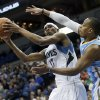 Photo - Minnesota Timberwolves' Corey Brewer, left, looks to shoot as Denver Nuggets' Randy Foye defends in the first quarter of an NBA basketball game Wednesday, Feb. 12, 2014, in Minneapolis. (AP Photo/Jim Mone)