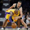 Los Angeles Lakers\' Kobe Bryant is defended by San Antonio Spurs\' Manu Ginobili, top, of Argentina, in the first half of an NBA basketball game in Los Angeles, Tuesday, Nov. 13, 2012. (AP Photo/Jae C. Hong)