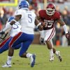 OU\'s Trey Millard (33) looks for more running room past KU\'s Greg Brown (5) during the college football game between the University of Oklahoma Sooners (OU) and the University of Kansas Jayhawks (KU) at Gaylord Family-Oklahoma Memorial Stadium on Saturday, Oct. 20th, 2012, in Norman, Okla. Photo by Chris Landsberger, The Oklahoman