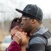 Kasmond Parker, right, consoles Cyndy Mann at the crash site where six teens were killed early in the morning on Park Ave. in Warren, Ohio on Sunday, March 10, 2013. (AP Photo/Scott R. Galvin)