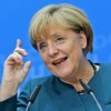 German Chancellor and chairwoman of the Christian Democratic party, CDU, Angela Merkel, raises a finger during a news conference after a party\'s board meeting in Berlin, Monday, Sept. 23, 2013. German Chancellor Angela Merkel may have won an impressive third general election but she faces a delicate and lengthy task in forming a new government as party leaders met Monday to map out their next steps. Merkel\'s Union bloc achieved its best result in 23 years Sunday to put her on course for a third term, winning 41.5 percent of the vote and finishing only five seats short of an absolute majority in the lower house. (AP Photo/Matthias Schrader)