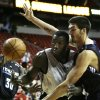 BYRON MULLENS: San Antonio Spurs\' first-round draft pick DeJuan Blair, center, battles for the ball with Oklahoma City Thunder\'s B.J. Mullens during their NBA Summer League Basketball game at Thomas & Mack Arena in Las Vegas on Thursday, July 16, 2009. (AP Photo/Laura Rauch) ORG XMIT: NVLR103