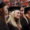 Julie Hite of Glencoe, left, and Pamela Cochrane of Yukon, display emotions after switching the tassels to the other side of their caps at the conclusion of graduation ceremony. Undergraduates at OSU participated in the school\'s 127th commencement ceremony the weekend of Friday, May 3 and Saturday, May 4, 2013 inside Gallagher-Iba Arena on the university\'s campus.These photos were taken at the Saturday morning ceremony when students from the College of Agricultural Sciences and Natural Resources, and the Spears School of Business were conferred with degrees. Photo by Jim Beckel, The Oklahoman.
