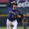 Photo - Colorado Rockies starting pitcher Jordan Lyles works against the Texas Rangers in the first inning of an interleague baseball game in Denver on Monday, May 5, 2014. (AP Photo/David Zalubowski)