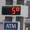 A bank thermometer reads in the single digits on Friday, Jan. 3, 2014, in Hazleton, Pa. Northern and eastern Pennsylvania saw 6 to 8 inches of snow, while southern and western Pennsylvania saw 2 to 5 inches, the National Weather Service said. (AP Photo/Hazleton Standard-Speaker, Eric Conover)
