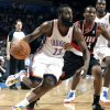 Oklahoma City\'s James Harden (13) drives to the basket as Portland \'s Nolan Smith (4) defends during the NBA basketball game between the Oklahoma City Thunder and the Portland Trail Blazers at Chesapeake Energy Arena in Oklahoma City, Sunday, March 18, 2012. Photo by Sarah Phipps, The Oklahoman.