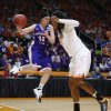 Photo - Northwestern State guard Beatrice Attura (30) is defended by Tennessee forward Bashaara Graves, right, in the first half of an NCAA women's college basketball first-round tournament game Saturday, March 22, 2014, in Knoxville, Tenn. (AP Photo/John Bazemore)