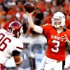 OSU\'s Brandon Weeden (3) throws a pass as WSU\'s Casey Hamlett (96) pressures him during the college football game between the Washington State Cougars (WSU) and the Oklahoma State Cowboys (OSU) at Boone Pickens Stadium in Stillwater, Okla., Saturday, September 4, 2010. Photo by Sarah Phipps, The Oklahoman