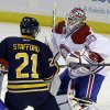 Buffalo Sabres\' Drew Stafford (21) battles for the puck with Montreal Canadiens\' Francis Bouillon (55) in front of goalie Peter Budaj, of Switzerland, during the first period of an NHL hockey game in Buffalo, N.Y., Thursday, Feb. 7, 2013. (AP Photo/David Duprey)