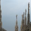 Photo - This July 6, 2012 photo shows spires of the Milan cathedral against the threatening skies in Milan, Italy. To travel through northern Italy with a copy of Mark Twain's 1869 ''The Innocents Abroad', his classic 'record of a pleasure trip'. It took him to the great sights of Europe and on to Constantinople and Jerusalem before he sailed home to New York. Such a trip would take far too big a chunk out of my holiday time. But, Milan, Florence and Venice, a mere fragment for Twain, was within my reach for a two-week vacation. (AP Photo/Raf Casert)
