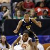 Oklahoma\'s Sharane Campbell (24) maintains control of the ball as she is knocked down by West Virginia\' Christal Caldwell, bottom rear, as Taylor Palmer (2) watches in the first half of an NCAA college basketball game at the Big 12 Conference women\'s tournament Saturday, March 9, 2013, in Dallas. (AP Photo/Tony Gutierrez)