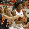 OSU\'s Toni Young (15) fights with Pepperdine\'s Katie Menton (23) for the ball during a first-round NIT women\'s college basketball game between Oklahoma State University (OSU) and Pepperdine at Gallagher-Iba Arena in Stillwater, Okla., Wednesday, March 16, 2011. Photo by Bryan Terry, The Oklahoman