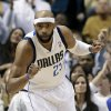 Dallas Mavericks\' Vince Carter (25) celebrates after dunking against the Los Angeles Lakers in the first half of an NBA basketball game Sunday, Feb. 24, 2013, in Dallas. (AP Photo/Tony Gutierrez)