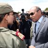 Photo - This photo provided by the Tunisian Presidency shows Tunisian President Moncef Marzouki visiting military officers in Jebel Chaambi, western Tunisia and close to the Algerian border, Tuesday, May 7, 2013. Tunisia's Defence Ministry says the army has surrounded a group of armed militants holed up in a mountain stronghold protected by homemade fertilizer bombs. (AP Photo/Tunisian Presidency)