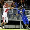 Prague\'s defensive back Damon Palmer (20) takes a pass from Little Axe\'s Jacob Bookout (5) in high school football on Friday, October 29, 2010, in Little Axe, Okla. This is the first home game for Little Axe since they rebuilt the football stadium after the tornado destroyed it in the spring. Photo by Steve Sisney, The Oklahoman
