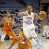 North Carolina\'s Allisha Gray (15) dribbles past Clemson\'s Chancie Dunn and Charmaine Tay (1) during the first half of an NCAA college basketball game in Chapel Hill, N.C., Thursday, Jan. 16, 2014. (AP Photo/Gerry Broome)
