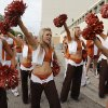 Members of the Texas cheer team bring in the Longhorn team busses during the Red River Rivalry college football game between the University of Oklahoma (OU) and the University of Texas (UT) at the Cotton Bowl in Dallas, Saturday, Oct. 13, 2012. Photo by Chris Landsberger, The Oklahoman