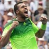 Photo - Jo-Wilfried Tsonga, of France, reacts after defeating Novak Djokovic, of Serbia, in a men's third round match at the Rogers Cup tennis tournament action in Toronto Thursday, Aug. 7, 2014. (AP Photo/The Canadian Press, Nathan Denette)