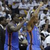 Oklahoma City Thunder players Kendrick Perkins, left, and Daequan Cook (14) celebrate in the final moments of the third overtime period of Game 4 against the Memphis Grizzlies in a second-round NBA basketball playoff series on Tuesday, May 10, 2011, in Memphis, Tenn. Oklahoma City won 133-123 in triple overtime. (AP Photo/Lance Murphey)