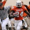 Photo - OSU: Oklahoma State University running back Kendall Hunter (24) makes a 58-yard touchdown run against Houston during the first half of an NCAA college football game in Stillwater, Okla. at Boone Pickens Stadium Saturday, Sept. 6, 2008. (AP Photo/Brody Schmidt) ORG XMIT: OKBS101