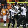 Photo - Baltimore Ravens kicker Justin Tucker (9) and quarterback Joe Flacco (5) celebrate after Tucker hit the game-winning field goal against the Denver Broncos in overtime of an AFC divisional playoff NFL football game, Saturday, Jan. 12, 2013, in Denver. The Ravens won 38-35. (AP Photo/Joe Mahoney)
