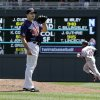 Photo -   Minnesota Twins pitcher Jason Marquis waits for a new ball after Cleveland Indians' Carlos Santana, right, hit a home run in the fifth inning of a baseball game, Tuesday, May 15, 2012, in Minneapolis. Marquis gave up three home runs in the inning and picked up the loss as the Indians shutout the Twins 5-0. (AP Photo/Jim Mone)
