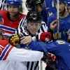 Photo - A linesman breaks up a scuffle between Czech Republic forward Martin Erat (91) and Sweden forward Henrik Zetterberg in the third period of a men's ice hockey game at the 2014 Winter Olympics, Wednesday, Feb. 12, 2014, in Sochi, Russia. (AP Photo/Julio Cortez)