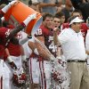 Oklahoma coach Bob Stoops gets dunked with in the final seconds of the Red River Rivalry college football game between the University of Oklahoma (OU) and the University of Texas (UT) at the Cotton Bowl in Dallas, Saturday, Oct. 13, 2012. Oklahoma won 63-21. Photo by Bryan Terry, The Oklahoman