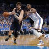 Memphis\' Marc Gasol (33) drives past Oklahoma City \'s Serge Ibaka (9) during Game 1 in the first round of the NBA playoffs between the Oklahoma City Thunder and the Memphis Grizzlies at Chesapeake Energy Arena in Oklahoma City, Saturday, April 19, 2014. Photo by Sarah Phipps, The Oklahoman