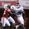 OU\'s Chris Brown (29) stiff arms Nebraska\'s Alfonzo Dennard (15) during the second half of the college football game between the University of Oklahoma Sooners (OU) and the University of Nebraska Cornhuskers (NU) on Saturday, Nov. 7, 2009, in Lincoln, Neb. Photo by Sarah Phipps, The Oklahoman