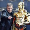 Photo - FILE - In this April 23, 2010 file photo, American actor Mark Hamill who played Luke Skywalker in the George Lucas Star Wars saga poses with a figure of the movie, C 3 PO, before the screening of