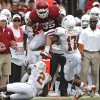 OU\'s Trey Millard (33) leaps over UT\'s Mykkele Thompson (2) and Adrian Phillips (17) during the Red River Rivalry college football game between the University of Oklahoma (OU) and the University of Texas (UT) at the Cotton Bowl in Dallas, Saturday, Oct. 13, 2012. Photo by Chris Landsberger, The Oklahoman