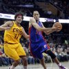 Photo - Detroit Pistons' Tayshaun Prince (22) drives past Cleveland Cavaliers' Anderson Varejao (17), from Brazil, during the first quarter of an NBA basketball game Saturday, Dec. 8, 2012, in Cleveland. (AP Photo/Tony Dejak)