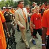 Photo - OSU head coach Mike Gundy walks to the stadium with his team during the Spirit Walk before a college football game between the Oklahoma State University Cowboys (OSU) and the Lamar University Cardinals at Boone Pickens Stadium in Stillwater, Okla., Saturday, Sept. 14, 2013. Photo by Nate Billings, The Oklahoman