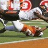 Oklahoma State\'s Justin Blackmon (81) dives past Texas\' Carrington Byndom (23) for a touchdown in the second quarter during a college football game between the Oklahoma State University Cowboys (OSU) and the University of Texas Longhorns (UT) at Darrell K Royal-Texas Memorial Stadium in Austin, Texas, Saturday, Oct. 15, 2011. Photo by Nate Billings, The Oklahoman