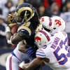 St. Louis Rams running back Steven Jackson (39) is tackled by a host of Buffalo Bills players including linebacker Nigel Bradham (53) during the second half of an NFL football game, Sunday, Dec. 9, 2012, in Orchard Park, N.Y. (AP Photo/Bill Wippert)