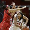 Photo - Rutgers forward Betnijah Laney (44) looks to make a pass around Louisville defenders during the second half of an NCAA college basketball game Tuesday, Jan. 28, 2014, in Piscataway, N.J. Louisville  won 80-71. (AP Photo/Mel Evans)